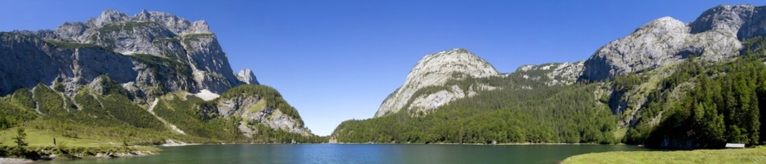 The small lake Gosausee and Dachstein mountains panorama