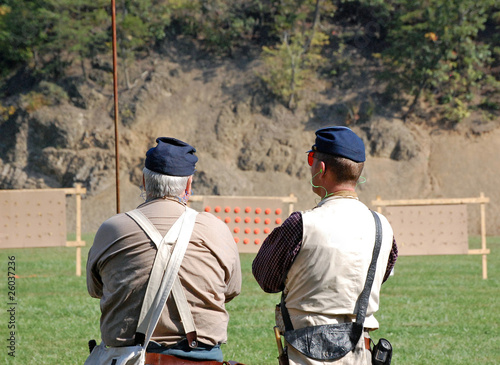 Two Shooters Prepare for Skirmish