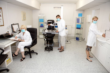 Three doctors in ophthalmology clinic