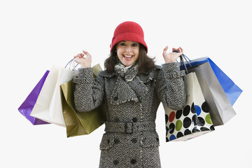 Woman in coat holding shopping bags