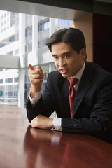 Angry Chinese businessman pointing