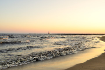 view of the Manistique lighthouse at sunset