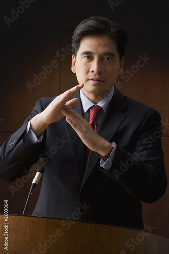 Chinese businessman making time out gesture
