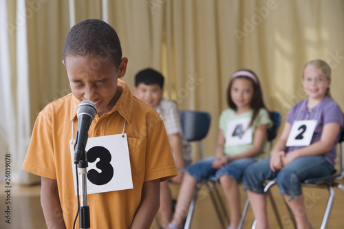 African boy giving answer in spelling bee