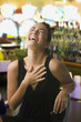 Glamorous mixed race woman laughing in casino
