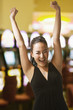 Glamorous mixed race woman in casino cheering