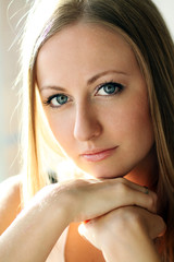 Closeup portrait of a cute young woman