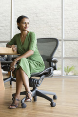 African businesswoman sitting in chair