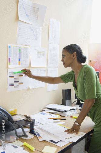 African businesswoman checking schedule
