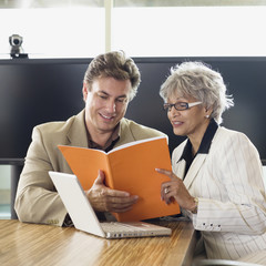 Businesspeople reading report together