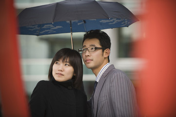Korean couple underneath umbrella