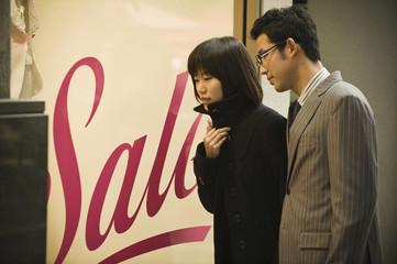 Korean couple window shopping