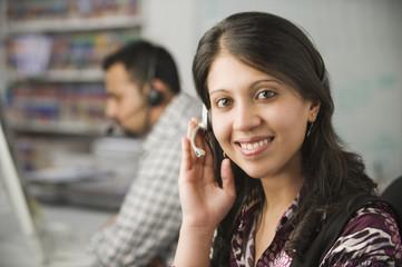 Indian businesswoman talking on headset