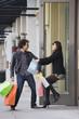 Woman pulling boyfriend into store