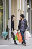 Couple leaving store with shopping bags