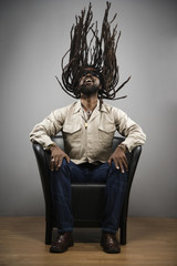 African man swinging dreadlocks