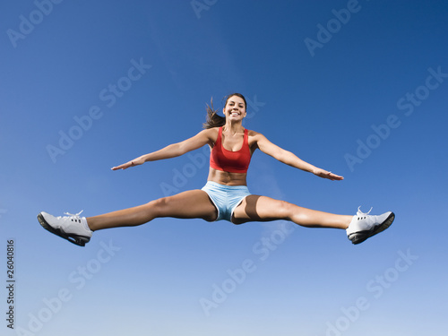 Native American woman jumping in mid-air