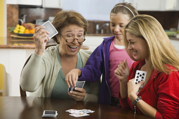 Hispanic family playing cards together