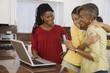 African granddaughter hugging grandmother holding credit card