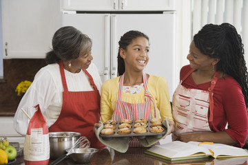 African family baking muffins together