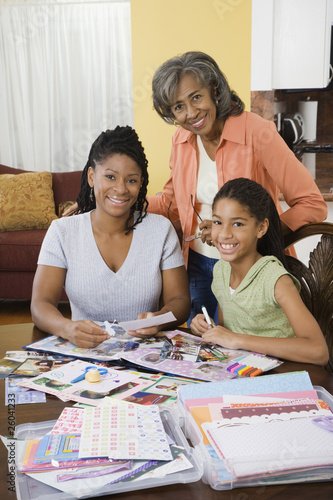 African family making scrapbook together