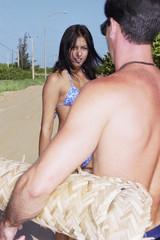 Friends in bathing suits walking on beach road