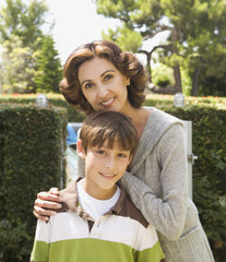 Portrait of Hispanic mother and son outdoors