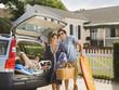 Hispanic family loading car for vacation