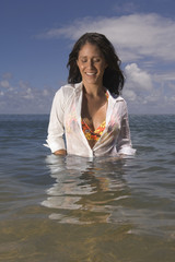 Pacific Islander woman standing in waist deep water