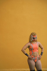 Hispanic woman wearing Mexican wrestling costume