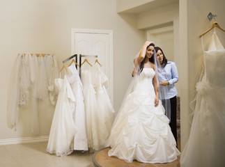 Hispanic woman trying on wedding dress