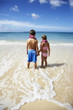 Boy and girl holding hands at beach