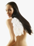 Nude Pacific Islander woman wearing wings