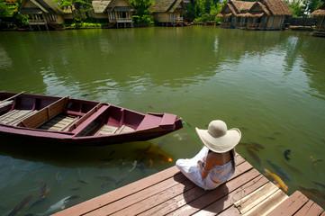 woman enjoying tropical lake view