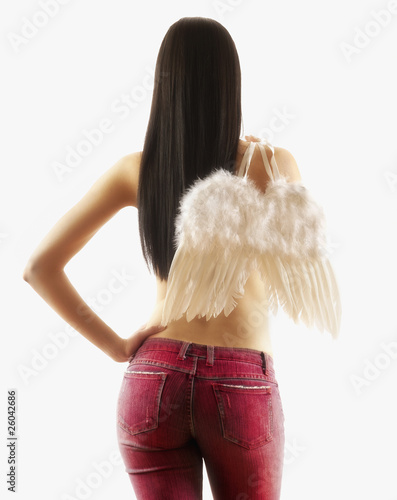 Pacific Islander woman holding wings over shoulder