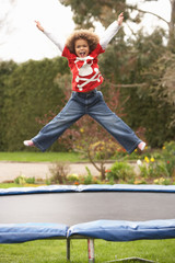 Boy Playing On Trampoline