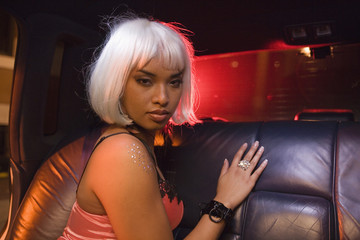 Portrait of prostitute in limousine