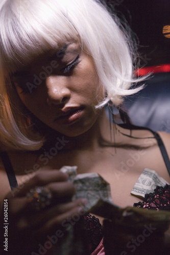 Close up of prostitute looking at money
