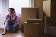 African woman talking on cell phone in new home