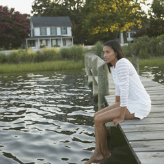 African woman sitting on dock