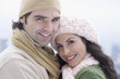 Portrait of Hispanic couple wearing winter clothing