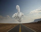 Remote road with cloud shaped like a hand
