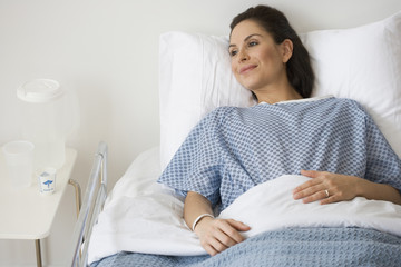 Hispanic woman laying in hospital bed