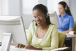 African businesswoman with headset at desk
