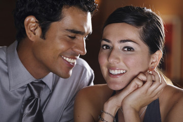 Close up of well dressed Hispanic couple smiling