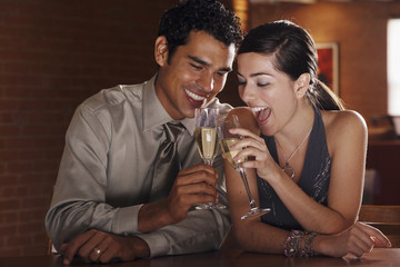 Hispanic couple toasting with champagne