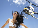 Helicopter flying over Pacific Islander woman