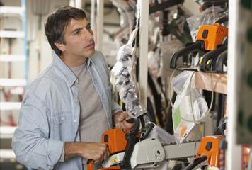 Hispanic man chainsaw shopping