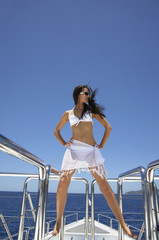 Pacific Islander woman on yacht