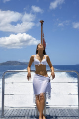 Pacific Islander woman on stern of boat